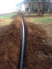 Drainage from downspouts install before landscape and/or sidewalks