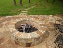 Outdoor fire pit build by Clean Green, inc.