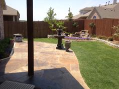 After complete the new flagstone patio, waterfall, stone border and landscape construction